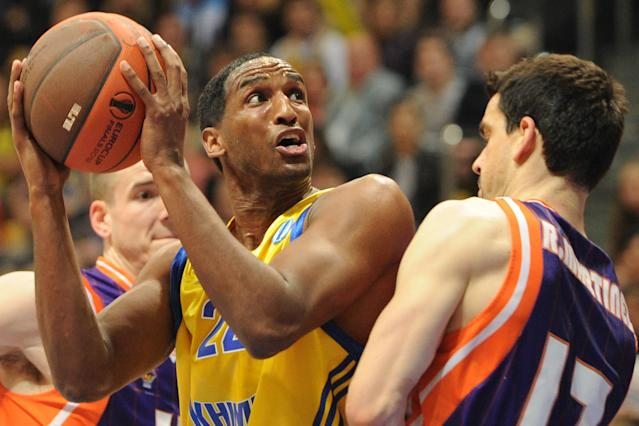 Valencia's Rafa Martinez (R) vies with BC Khimki's Thomas Kelati during the Eurocup final basketball match between BC Khimki and Valencia in Khimki, outside Moscow on April 15, 2012. AFP PHOTO / KIRILL KUDRYAVTSEV (Photo credit should read KIRILL KUDRYAVTSEV/AFP/Getty Images)