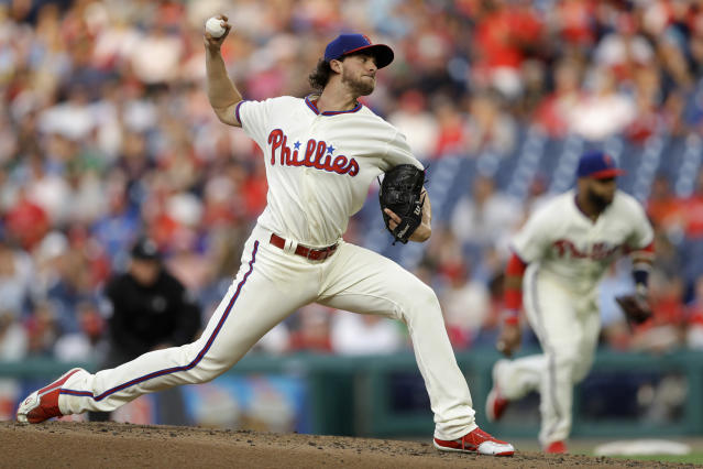 Philadelphia Phillies' Aaron Nola pitches during the third inning of a baseball game against the Colorado Rockies, Tuesday, June 12, 2018, in Philadelphia. (AP Photo/Matt Slocum)