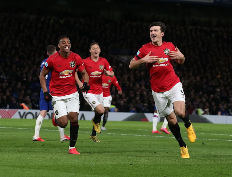 Harry Maguire of Manchester United celebrates scoring their second goal during the Premier League match between Chelsea FC and Manchester United at Stamford Bridge on February 17, 2020 in London, United Kingdom.