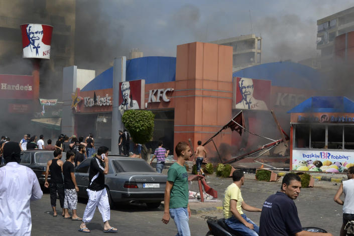 Lebanese protesters attack American fast food restaurants after Friday prayers, pouring petrol on the restaurants and setting them on fire in the northeastern city of Tripoli, Lebanon, Friday Sept. 14, 2012. According to security officials no one was hurt in the attack which is part of widespread anger across the Muslim world about a film ridiculing Islam's Prophet Muhammad. (AP Photo)