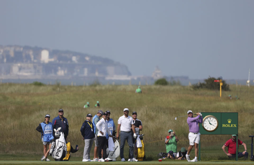 England's Lee Westwood, second right, tees off from the 16th watched by United States' Dustin Johnson at centre during, a practice round for the British Open Golf Championship at Royal St George's golf course Sandwich, England, Tuesday, July 13, 2021. The Open starts Thursday, July, 15. (AP Photo/Ian Walton)