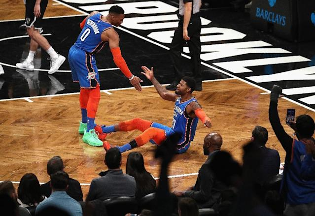 Oklahoma City's Paul George and Russell Westbrook celebrate a shot in the Thunder's 114-112 NBA victory over the Brooklyn Nets (AFP Photo/AL BELLO)
