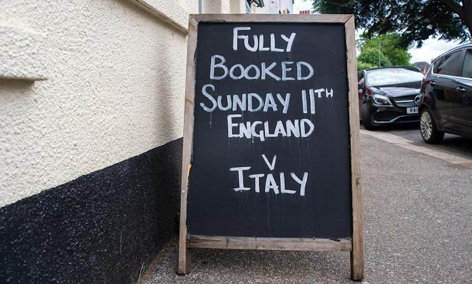A fully booked sign outside a pub