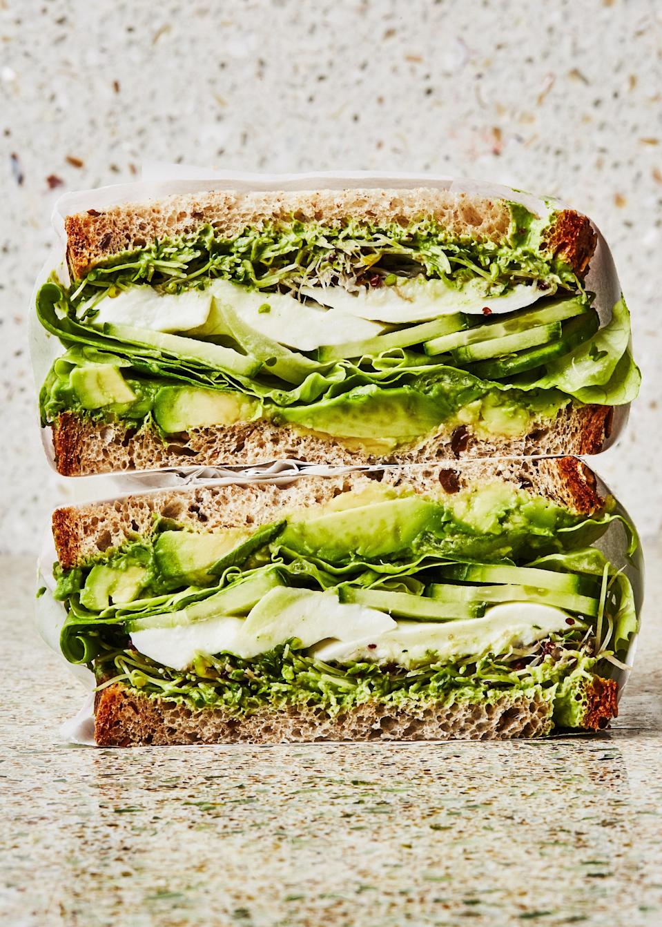 """Up the creamy factor of your sandwich by layering in some ripe avocado, plus mozzarella, and a tangy Greek yogurt-based dressing. <a href=""""https://www.epicurious.com/recipes/food/views/green-goddess-crunch-sandwich?mbid=synd_yahoo_rss"""" rel=""""nofollow noopener"""" target=""""_blank"""" data-ylk=""""slk:See recipe."""" class=""""link rapid-noclick-resp"""">See recipe.</a>"""