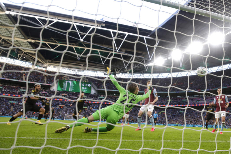 Manchester City's Sergio Aguero, left, scores his side's first goal during the League Cup soccer match final between Aston Villa and Manchester City, at Wembley stadium, in London, England, Sunday, March 1, 2020. (AP Photo/Alastair Grant)