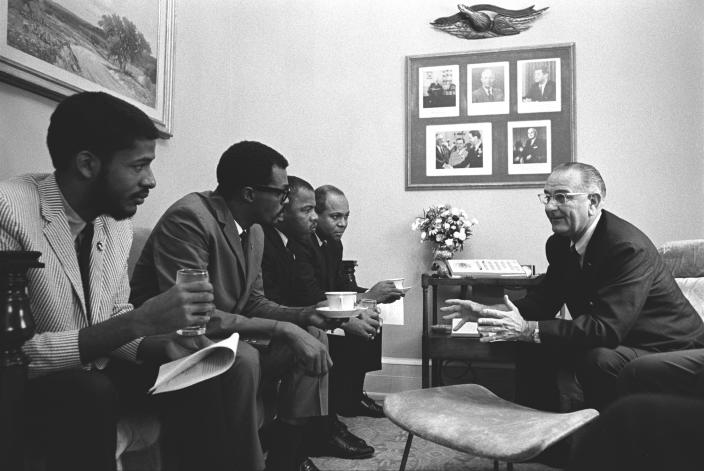Civil rights activists John Lewis and James Farmer sit with President Lyndon Baines Johnson at the White House. (Photo: Okamoto/Interim Archives/Getty Images)