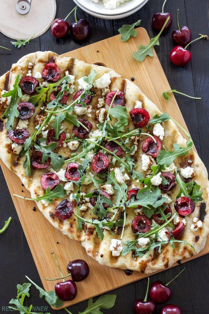 "<p>This is basically the prettiest pizza we've ever seen.</p><p>Get the recipe from <a href=""http://reciperunner.com/grilled-cherry-goat-cheese-arugula-pizza/"" rel=""nofollow noopener"" target=""_blank"" data-ylk=""slk:Recipe Runner"" class=""link rapid-noclick-resp"">Recipe Runner</a>.</p>"