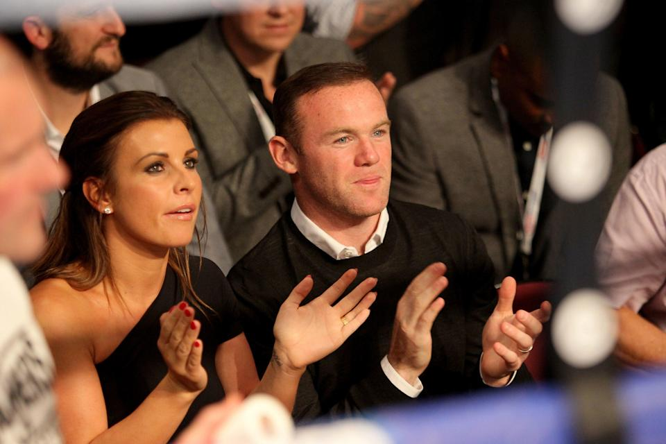 Wayne Rooney pictured with his wife Coleen Rooney (PA)