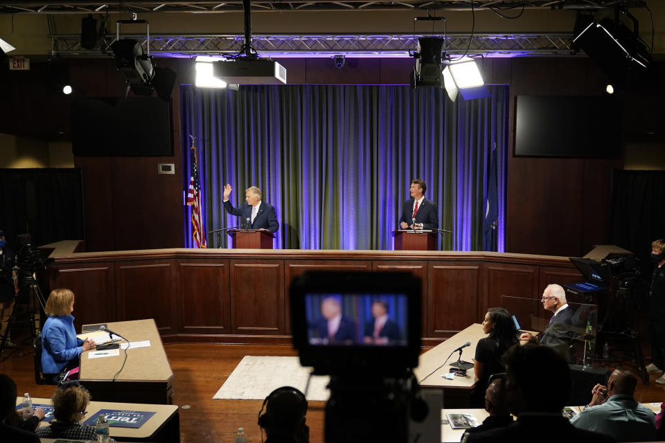Democratic gubernatorial candidate former Governor Terry McAuliffe, left, and Republican challenger, Glenn Youngkin, prepare for a debate at the Appalachian School of Law in Grundy, Va., Thursday, Sept. 16, 2021. (AP Photo/Steve Helber)