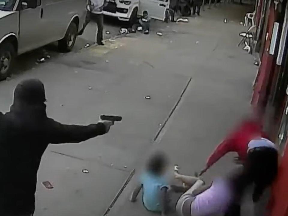 Chilling footage shows two children get caught up in New York shooting