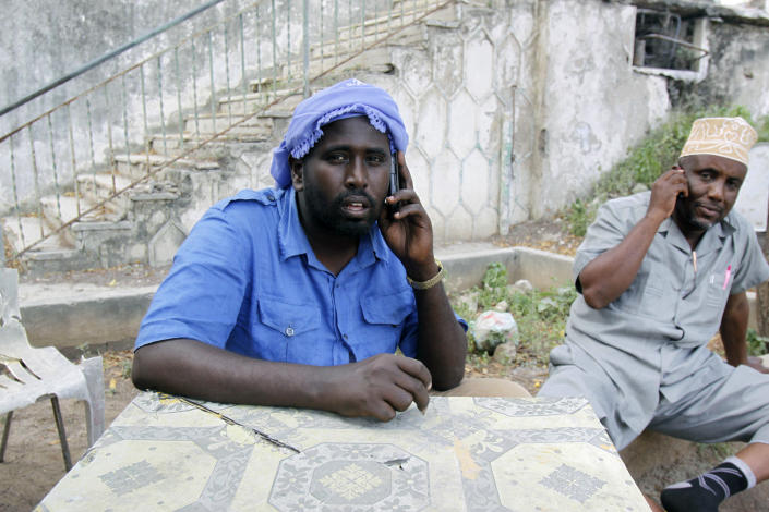In this Wednesday, Sept. 18, 2013 photo, two Somali real estate agents speak on the phone with clients hunting for real estate property on sale, in Mogadishu, Somalia. Despite the occasional militant attack, this seaside city's real estate market has seen an upsurge in demand over the last two years, thanks in part to security gains made following the ouster of the al-Qaida-linked Islamic rebels of al-Shabab. (AP Photo/Farah Abdi Warsameh)