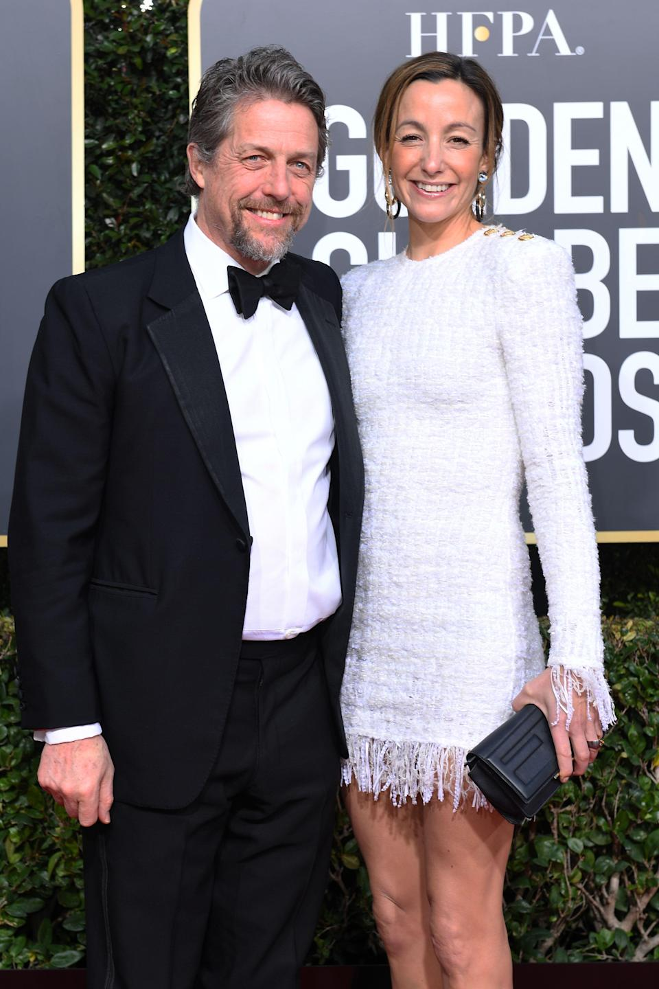 Best Performance by an Actor in a Limited Series or Motion Picture Made for Television for 'A Very English Scandal' nominee Hugh Grant (L) and his wife producer Anna Elisabet Eberstein arrive for the 76th annual Golden Globe Awards on January 6, 2019. (Photo by VALERIE MACON / AFP)