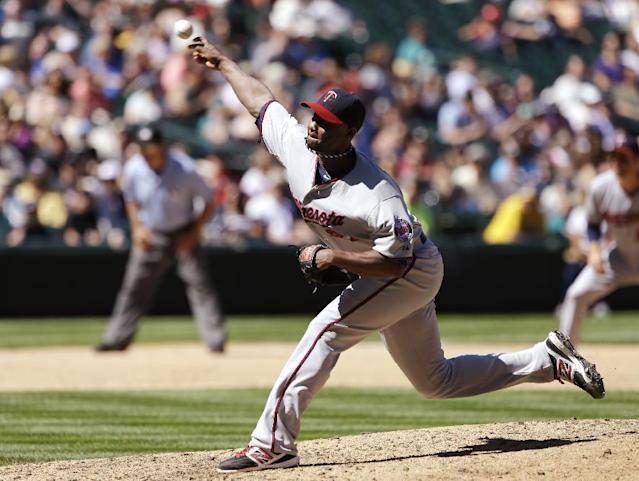 Minnesota Twins starting pitcher Samuel Deduno throws against the Seattle Mariners in the sixth inning of a baseball game, Saturday, July 27, 2013, in Seattle. (AP Photo/Elaine Thompson)