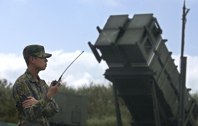 In this Oct. 22, 2004 photo, a Taiwanese soldier stands in attention in front of a Patriot missile air defense system near the northern coastal town of Wanli, Taiwan. With the fourth Taiwanese in only 14 months known to have been picked up by authorities on charges of spying for China, it appears that the rival mainland is aggressively targeting high-tech US-made defense systems on the island. (AP Photo/Wally Santana)