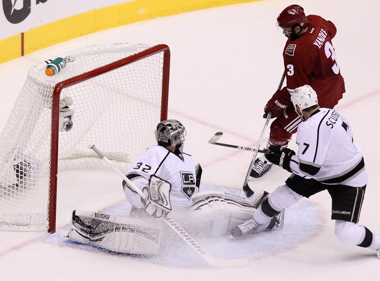GLENDALE, AZ - MAY 22:  Keith Yandle #3 of the Phoenix Coyotes scores past goaltender Jonathan Quick #32 of the Los Angeles Kings in the second period of Game Five of the Western Conference Final during the 2012 NHL Stanley Cup Playoffs at Jobing.com Arena on May 22, 2012 in Phoenix, Arizona.  (Photo by Jeff Gross/Getty Images)