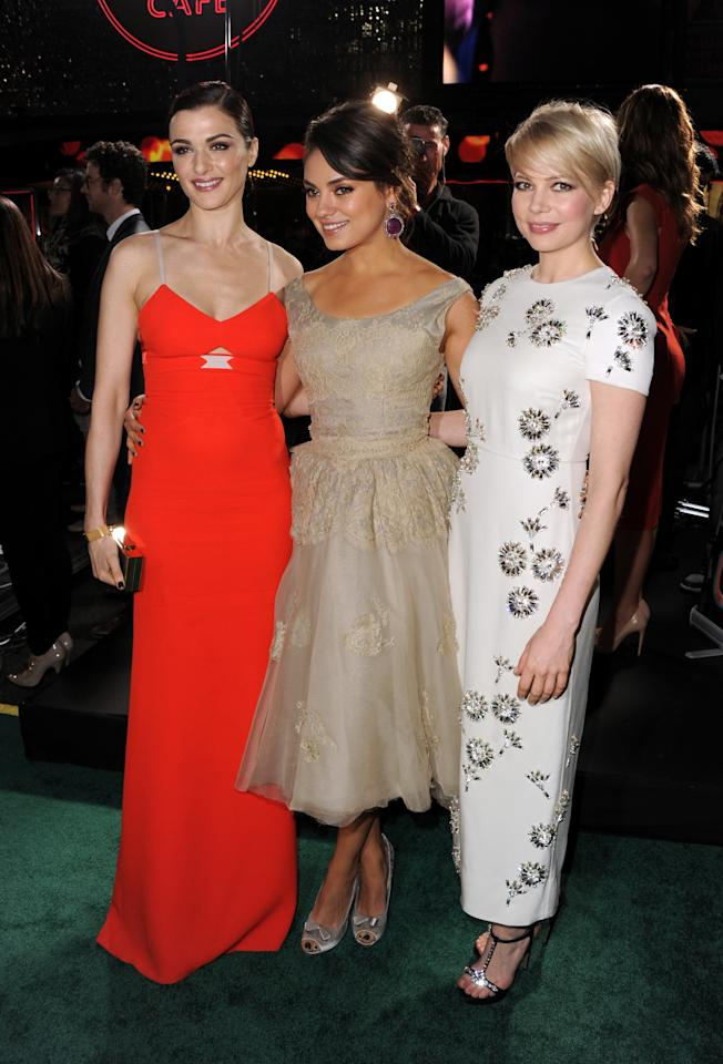"""HOLLYWOOD, CA - FEBRUARY 13:  (L-R) Actresses Rachel Weisz, Mila Kunis and Michelle Williams attend the world premiere of Walt Disney Pictures' """"Oz The Great And Powerful"""" at the El Capitan Theatre on February 13, 2013 in Hollywood, California.  (Photo by Kevin Winter/Getty Images)"""