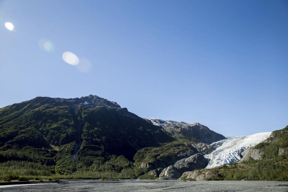 FILE - This Tuesday, Sept. 1, 2015 file photo shows the Exit Glacier in Seward, Alaska, which according to National Park Service research has retreated approximately 1.25 miles over the past 200 years. According to a study released on Wednesday, April 28, 2021 in the journal Nature, the world's 220,000 glaciers are melting faster now than in the 2000s. (AP Photo/Andrew Harnik)