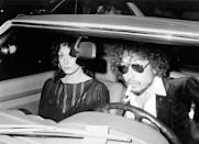<p>Bob Dylan arrives at an event driving a Mercedes in 1976.</p>