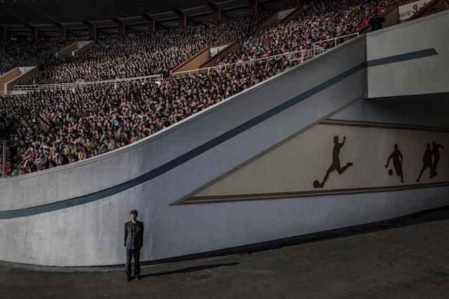 <p>North Korea: A huge crowd at the Kim Il Sung stadium awaits the start of the Pyongyang marathon. An official guards the exit in Pyongyang, North Korea, April 9, 2017.<br>More than 50,000 spectators assembled to see the start of the marathon. Thousands more gathered on the streets of the North Korean capital along a route that took runners past such landmarks as the Arch of Triumph, Kim Il-sung Square and the Grand Theatre. North Korea is one of the most isolated and secretive nations on earth. A leadership cult has grown around the Kim dynasty, passing from Kim Il-sung (the Great Leader) to his son Kim Jong-il (the Dear Leader) and grandson, the current supreme leader Kim Jong-un. The country is run along rigidly state-controlled lines. Local media are strictly regulated, and the foreign press largely excluded, or, if allowed access closely accompanied by minders. (Photo: Roger Turesson, Dagens Nyheter) </p>
