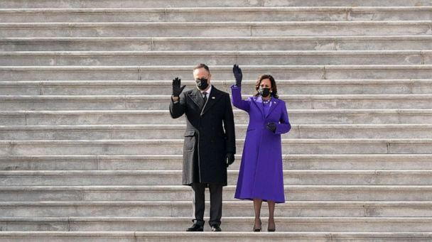 PHOTO: Vice President Kamala Harris and her husband Doug Emhoff wave as former Vice President Mike Pence and his wife Karen Pence depart the Capitol after the Inauguration of President Joe Biden at the U.S. Capitol in Washington, D.C., Jan. 20, 2021. (J. Scott Applewhite/AP)