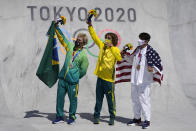 From left, silver medal winner Pedro Barros of Brazil, gold medal winner Keegan Palmer of Australia and bronze medal winner Cory Juneau of the United States pose for photos after the the men's park skateboarding finals at the 2020 Summer Olympics, Thursday, Aug. 5, 2021, in Tokyo, Japan. (AP Photo/Ben Curtis)