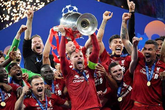 Soccer Football - Champions League Final - Tottenham Hotspur v Liverpool - Wanda Metropolitano, Madrid, Spain - June 1, 2019 Liverpool's Jordan Henderson lifts the trophy as they celebrate after winning the Champions League REUTERS/Toby Melville
