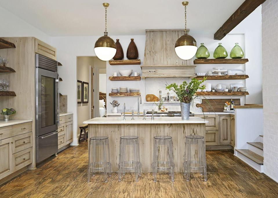 "<p>If you can't get enough of the reclaimed-wood look, here are two words you'll be hearing a lot: pecky cypress. Seen here on the hood and island, it's a type of wood that has a grainy texture thanks to long, narrow burrows or cavities.</p><p><strong>Bonus idea: </strong>From boxy appliances and islands to linear shelves, kitchens tend to have a lot of straight lines. Soften the room with orb lights.</p><p><a class=""link rapid-noclick-resp"" href=""https://www.amazon.com/catalina-lighting-19968-000-11-inch-Pendant-x/dp/B071JZJG18/?tag=syn-yahoo-20&ascsubtag=%5Bartid%7C10050.g.3988%5Bsrc%7Cyahoo-us"" rel=""nofollow noopener"" target=""_blank"" data-ylk=""slk:SHOP ORB LIGHTS"">SHOP ORB LIGHTS</a></p>"