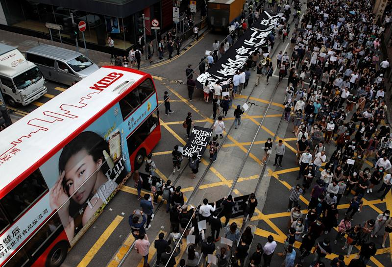People attend a rally after the news broke that Chow Tsz-lok, 22, a university student who fell during protests at the weekend, died early on Friday morning, in Hong Kong, China November 8, 2019. REUTERS/Ahmad Masood