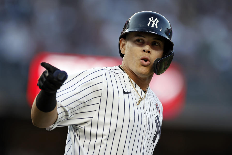 New York Yankees' Gio Urshela reacts after hitting a three-run home run during the second inning of the second baseball game of a doubleheader against the New York Mets on Sunday, July 4, 2021, in New York. (AP Photo/Adam Hunger)