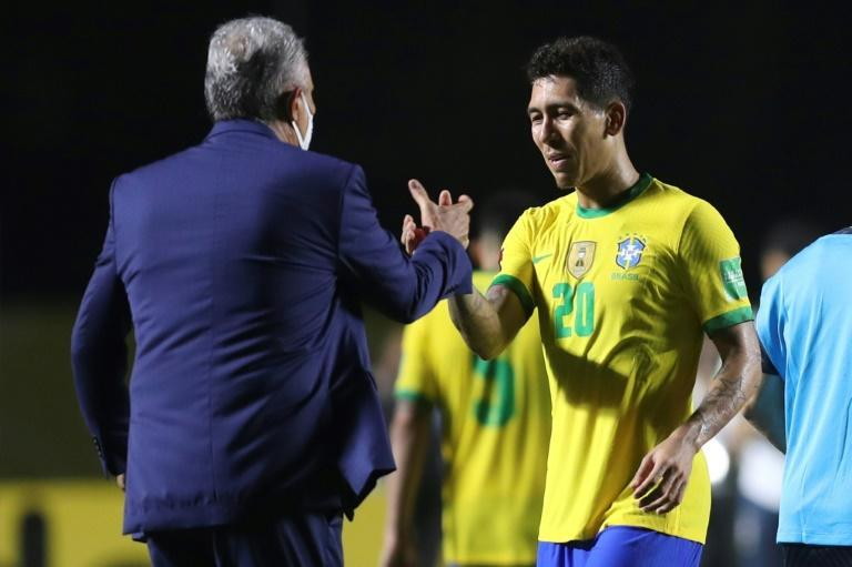 Brazil's coach Tite greets goal-scorer Roberto Firmino after defeating Venezuela 1-0 in their closed-door World Cup qualifier in Sao Paulo on Friday
