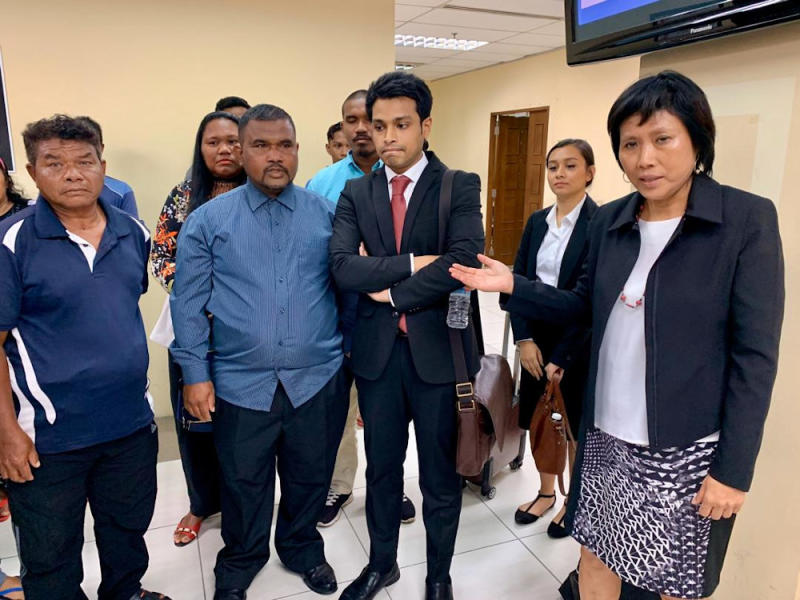 Lawyer Tan Poh Lai (far right) with representatives of the Orang Seletar at the Johor Baru Civil High Court at Menara Cyberport in Johor Baru today. — Picture by Ben Tan