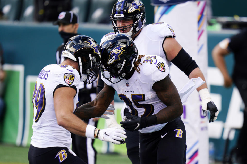 Baltimore Ravens' Gus Edwards (35) celebrates with Mark Andrews (89) after scoring a touchdown during the first half of an NFL football game against the Philadelphia Eagles, Sunday, Oct. 18, 2020, in Philadelphia. (AP Photo/Chris Szagola)