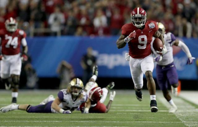 Bo Scarbrough ran all over Washington on Saturday for 180 yards and two TDs. (Getty)
