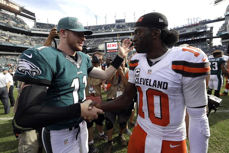 Carson Wentz, left, outplayed Robert Griffin III, right, on Sunday (AP).