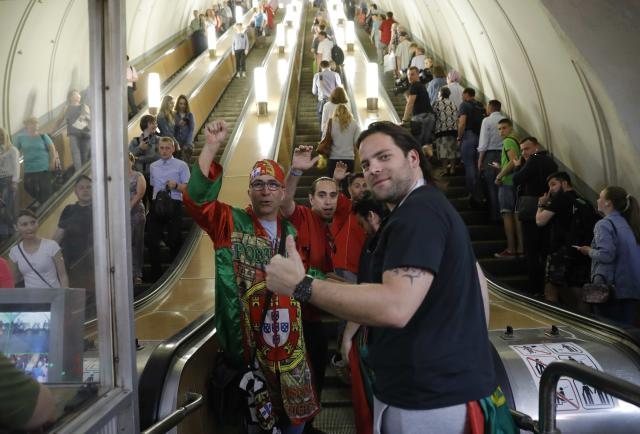 Portugal fans travel on the escalator at a metro station in Moscow, the host city for the 2018 FIFA World Cup, Russia June 21, 2018. REUTERS/Tatyana Makeyeva
