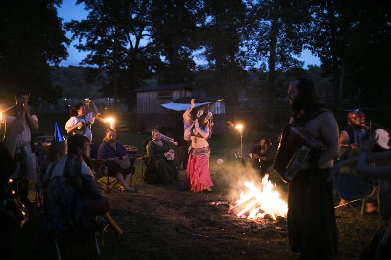 Rag attendees drink, dance and make merriment around the fire at an after-hours campout. (Maddie McGarvey for HuffPost)