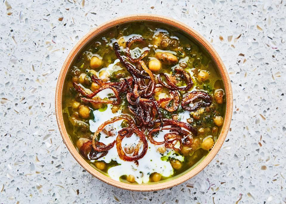 "This soup is inspired by <em>ash reshteh</em>, a thick Iranian soup made with chickpeas, a boatload of herbs, and noodles, with one big exception: We omitted the noodles. If you don't have time to soak the chickpeas and beans overnight, bring them to a boil in separate pots of water, then turn off the heat, cover the pots, and let them sit for 1 hour before proceeding. <a href=""https://www.bonappetit.com/recipe/beans-green-soup-with-yogurt-mint?mbid=synd_yahoo_rss"" rel=""nofollow noopener"" target=""_blank"" data-ylk=""slk:See recipe."" class=""link rapid-noclick-resp"">See recipe.</a>"