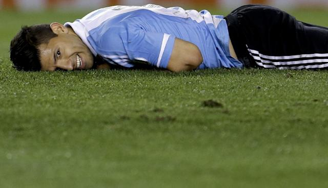 FILE - In this Oct. 11, 2013, file photo, Argentina's Sergio Aguero smiles after falling on the pitch during a 2014 World Cup qualifying soccer match against Peru in Buenos Aires, Argentina. (AP Photo/Natacha Pisarenko,File)