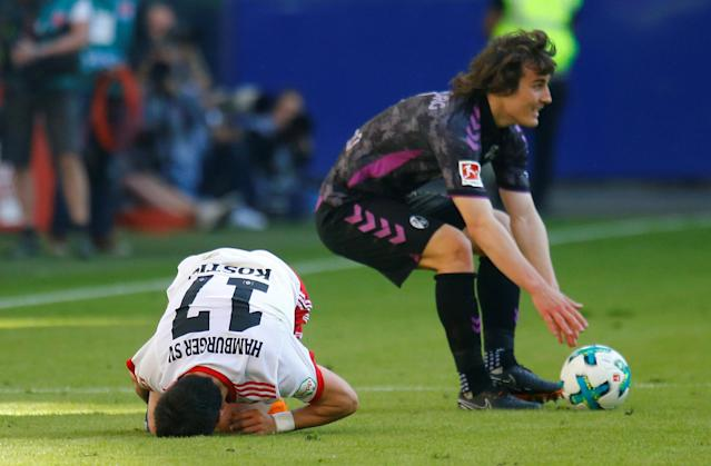 Soccer Football - Bundesliga - Hamburger SV vs SC Freiburg - Volksparkstadion, Hamburg, Germany - April 21, 2018 SC Freiburg's Caglar Soyuncu after fouling Hamburg's Filip Kostic REUTERS/Morris Mac Matzen DFL RULES TO LIMIT THE ONLINE USAGE DURING MATCH TIME TO 15 PICTURES PER GAME. IMAGE SEQUENCES TO SIMULATE VIDEO IS NOT ALLOWED AT ANY TIME. FOR FURTHER QUERIES PLEASE CONTACT DFL DIRECTLY AT + 49 69 650050