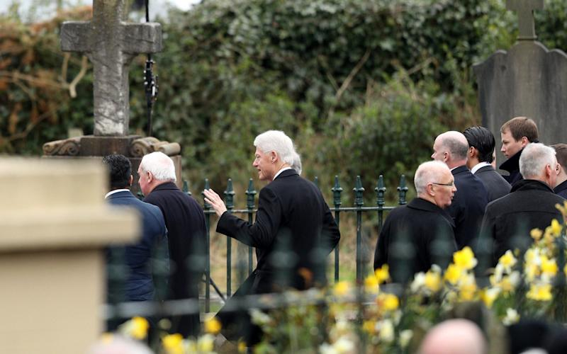 Clinton arrives at the service. McGuinness was once chief of staff of the IRA but later became Sinn Fein's chief negotiator in the talks that led to the Good Friday agreement bringing peace to Northern Ireland - Credit: Dan Kitwood/Getty Images Europe