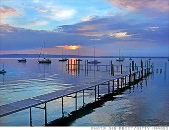 """<b><a target=""""_blank"""" href=""""https://homes.yahoo.com/search/Michigan/Traverse_City/homes-for-sale"""">Traverse City, MI</a></b><br><br><b>Best if you're looking for:</b> Resort area<br><b>Median home price:</b> $195,000<br><b>Top state income tax:</b> 4.35% (4.25% in 2013)<br><br>Retiring to the water doesn't have to mean giving up four seasons or downsizing to a tiny condo. In Traverse City, residents enjoy miles of sandy beaches and all the spoils of Lake Michigan and nearby inland lakes -- where waterfront homes can be found for less than $200,000.<br><br>Moreover, despite Traverse City's location on the northwestern side of the state, it has fairly urban-like amenities, such as the 391-bed Munson Medical Center, which consistently ranks among the 100 top hospitals in the country. And the nearby Interlochen Center for the Arts brings in hundreds of concerts, art exhibits, and theatrical and dance productions each year."""