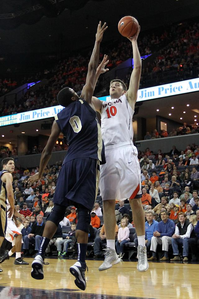 Virginia forward/center Mike Tobey (10) shoots over Navy forward Will Kelly during the first half of an NCAA basketball game Tuesday Nov. 19, 2013 in Charlottesville, Va. (AP Photo/Andrew Shurtleff)