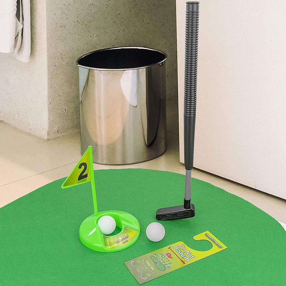 <p>The <span>Toilet Game</span> ($15, originally $20) will keep them busy in the bathroom no matter how long they are in there for. It comes with a gold club, a dedicated green that wraps around the toilet, two gold balls, a moveable hole for different targets, a flag and a do not disturb sign. </p>