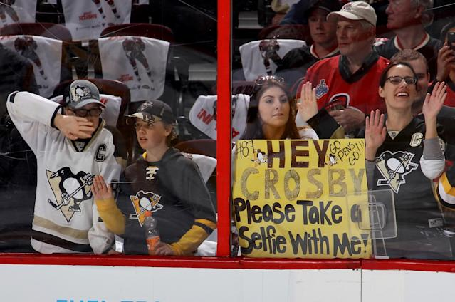 <p>A Pittsburgh Penguins fan holds a sign that reads, 'Hey Crosby Please Take A Selfie With Me!' prior to Game Four of the Eastern Conference Final against the Ottawa Senators during the 2017 NHL Stanley Cup Playoffs at Canadian Tire Centre on May 19, 2017 in Ottawa, Canada. (Photo by Jana Chytilova/Freestyle Photo/Getty Images) </p>