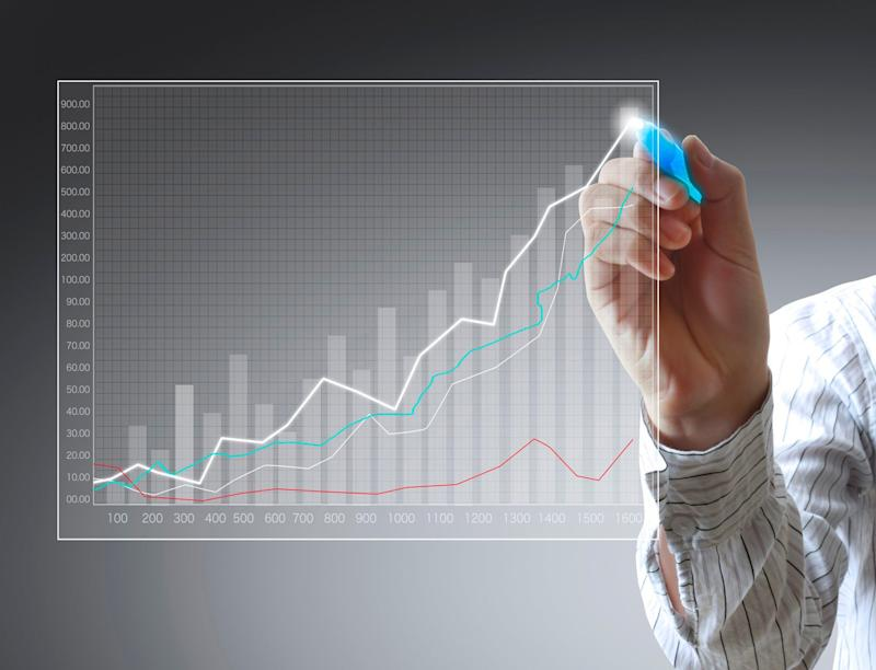 A person points to several upward inclined lines on a chart.