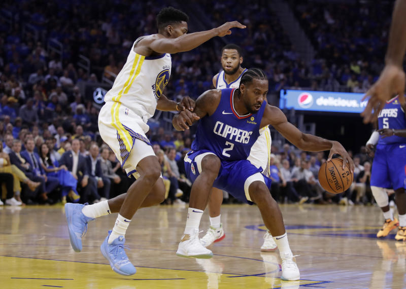 Los Angeles Clippers' Kawhi Leonard (2) drives the ball against Golden State Warriors' Glenn Robinson III, left, during the first half of an NBA basketball game Thursday, Oct. 24, 2019, in San Francisco. (AP Photo/Ben Margot)