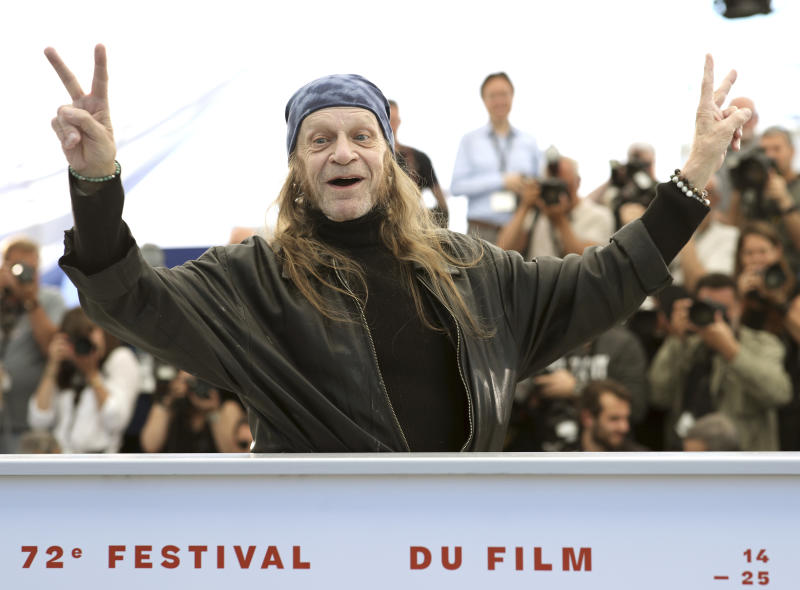 Actor Leon Vitali poses for photographers at the photo call for the film 'The Shining' at the 72nd international film festival, Cannes, southern France, Thursday, May 16, 2019. (AP Photo/Petros Giannakouris)