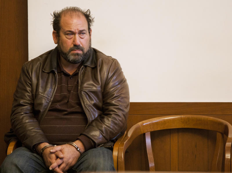 Film director Daniel Adams waits to be arraigned in Boston Municipal Court  Friday, Dec. 9, 2011, where he was charged with inflating expenses in his application for Massachusetts film tax credits, resulting in about $4.7 million in overpayments. (AP Photo/ Dominick Reuter, Pool)