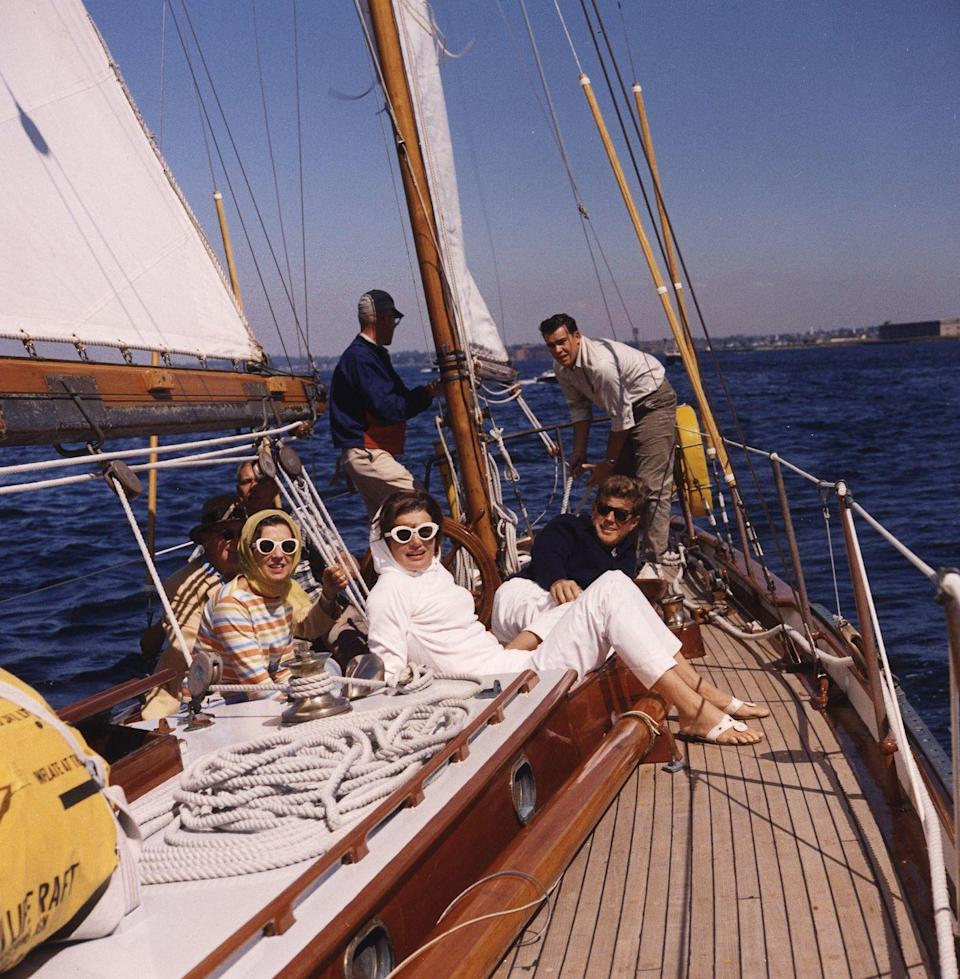 <p>JFK and Jackie spend the day sailing in Newport, Rhode Island during America's Cup. </p>