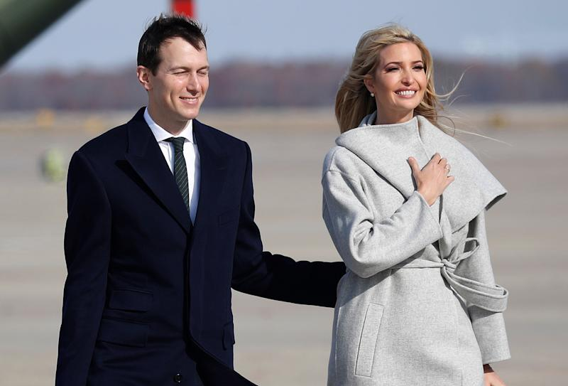 White House Senior Adviser Jared Kushner, left and Ivanka Trump, the daughter and assistant to President Donald Trump walk across the tarmac before boarding Air Force One, Thursday, Nov. 29, 2018 at Andrews Air Force Base, Md. (AP Photo/Pablo Martinez Monsivais)